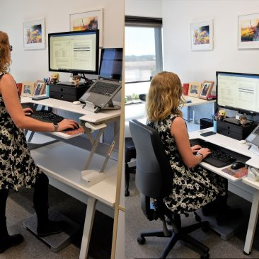 Cass Hill demonstrating Sit stand desk and ergonomic work station