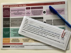 Image of SA government information sheet provided and contact tracing papers