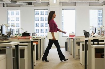 Image of office worker walking through the office